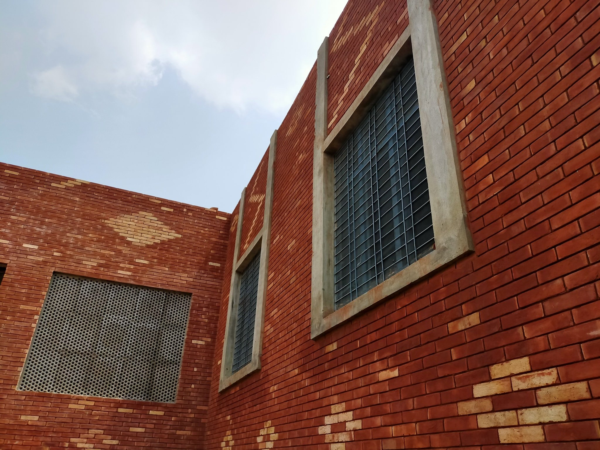 Red brick gutka tile designs in pakistan